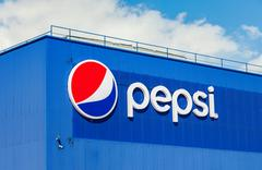 Logotype of Pepsi Corporation against the blue sky Stock Photos