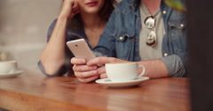 Man's hands holding Phone in Coffee Shop Stock Footage