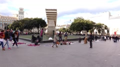 Illegal migrant hawkers at Placa Catalunya, sell counterfeit items from ground. Stock Footage