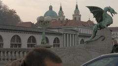 Dragon Bridge crossed by cars, bikes and people in Ljubljana Stock Footage