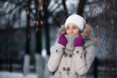 Beautiful blond hair girl i winter clothes. Emotive portrait of a fashionable - stock photo