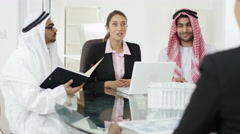 4K Smiling Arabic & Western business group in meeting shake hands on a deal Stock Footage