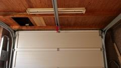 Garage door of a detached house opening Stock Footage
