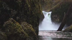 Extreme Kayaker Paddles Off Beautiful Waterfall Slow Motion - stock footage