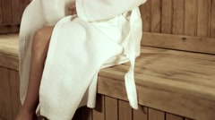 Relaxed woman relaxing in a wooden sauna Stock Footage