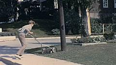 Niagara Falls 1965: teenager cutting grass Stock Footage