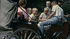 Montreal 1965: family during a sightseeing tour in a horse carriage Stock Footage