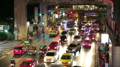 Bangkok colorful traffic flow on intersection - stock footage