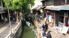 Tourists walking in the streets of Suzhou, China Stock Footage