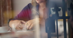 Hipster Woman eats Croissant in Coffee Shop - stock footage