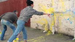 Free Artists, Street artist splashing paint on outer wall - stock footage