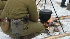 The soldiers cooked porridge on the fire. Stock Footage