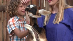 Young Boy Petting Goat Stock Footage