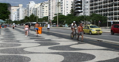 Tourists walking on the famous Copacabana beach, Rio de Janeiro, Brazil Stock Footage