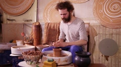 Potter making clay jug - stock footage