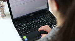 Young girl using laptop and writing keyboard (amors shot ) Stock Footage