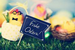 Text Frohe Ostern, happy Easter in German Stock Photos