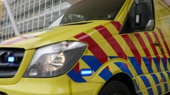 Dutch Ambulance on the scene during an enacted emergency with blue lights on - stock footage