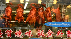 Hong Kong China Peking duck hanging in window Kowloon Woosung Street with - stock footage