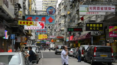 Hong Kong China traffic Kowloon Woosung Street with cars and signs overhanging - stock footage
