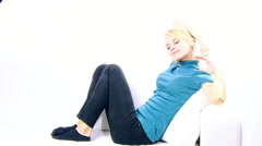 Beautiful blonde skinny woman at home on sofa stretching happy in the morning - stock footage