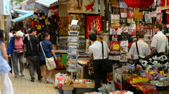 Hong Kong China Stanley Market shops with tourists buying souvenirs  at famous Stock Footage