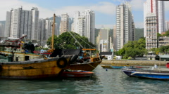 Hong Kong China Aberdeen from boat in water of reclaimed land with skyscraper - stock footage