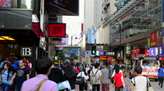 Stock Video Footage of Hong Kong China downtown busy Causeway Bay district with shoppers and business
