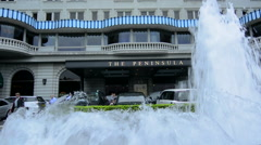 Hong Kong China  Peninsula Hotel pink fountains in front of expensive exclusive Stock Footage