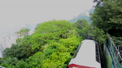 Hong Kong China Victoria Peak Tram going down mountain on smoggy hazy foggy day Stock Footage