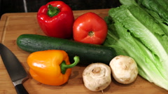 Overhead pan across vegetables on cutting board - stock footage