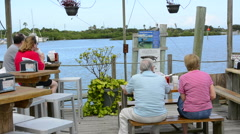 New Smyrna Beach Florida older couples at local restaurant called Dolphin View Stock Footage