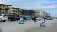 New Smyrna Beach Florida driving cars on beach traffic danger speed limits with Stock Footage
