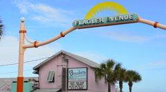 New Smyrna Beach Florida famous Flagler Avenue entrance to drive on beach with Stock Footage