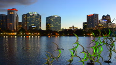 Orlando Florida Lake Eola Take Flight Douse Blumberg skyline twilight night - stock footage
