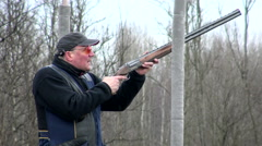 An elderly man is shooting sports shotguns. Stock Footage