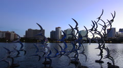 Orlando Florida Lake Eola Take Flight Douse Blumberg skyline twilight colored - stock footage