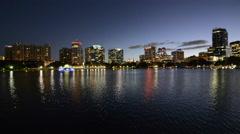 Orlando Florida Lake Eola skyline twilight night colored lights statue night - stock footage