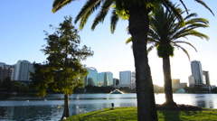 Orlando Florida Lake Eola Take skyline and fountain at  twilight with water and Stock Footage