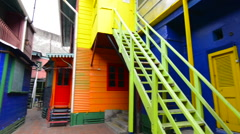Buenos Aires Argentina La Boca colorful bright primary colors doors and stairs Stock Footage