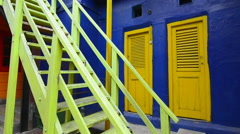 Buenos Aires Argentina La Boca colorful bright primary colors doors and stairs - stock footage