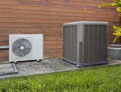 Two different sized air conditioning heat pumps - stock photo