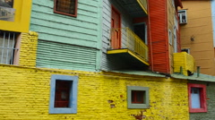 Buenos Aires Argentina La Boca colorful bright primary colors worn walls and - stock footage