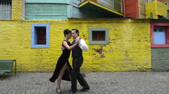 Buenos Aires Argentina La Boca tango dance with couple on street with colors Stock Footage