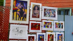 Buenos Aires Argentina La Boca colorful street selling paintings and drawings Stock Footage