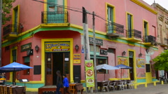 Buenos Aires Argentina La Boca colorful shops with statues and souvenirs to sell Stock Footage
