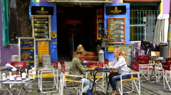 Buenos Aires Argentina La Boca colorful restaurant with young women having drink - stock footage