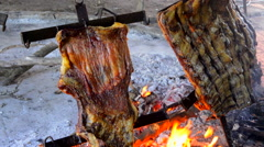 Buenos Aires Argentina cooking food beef ribs on fire Gaucho cowboy ranch for Stock Footage
