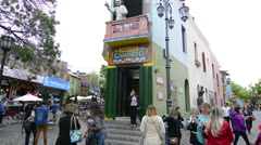 Buenos Aires Argentina La Boca colorful streets and buildings with tourists on Stock Footage