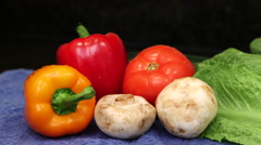 Pan across vegetables on blue cloth Stock Footage